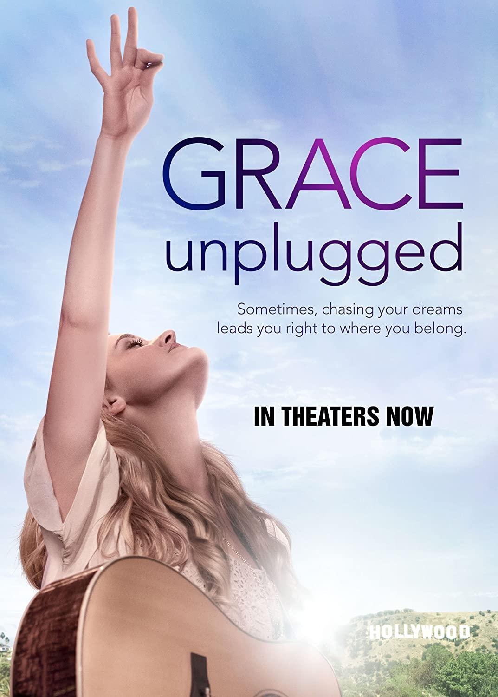 imagem do filme Grace - entre a fé e a fama - menina com violão e braço levando para o céu